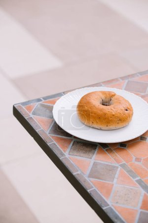 Photo for Breakfast Morning Sunny warm weather with donut on white plate on table background. Good mood Horizontal view - Royalty Free Image