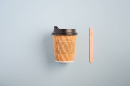 Photo for Take away coffee on blue background, top view, flat lay, copy space. - Royalty Free Image