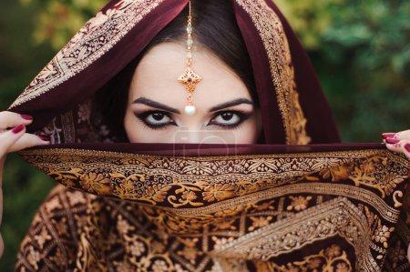 Photo for Portrait of beautiful indian girl . Young hindu woman model with tatoo mehndi and kundan jewelry - Royalty Free Image
