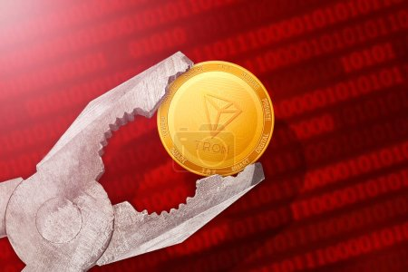 Photo for Tron regulation, control; tron TRX golden coin is under pressure - Royalty Free Image