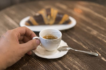 Photo for Fresh and tasty croissant with chocolate and cup of coffee on wooden background. - Royalty Free Image