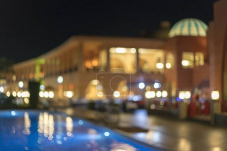 Photo for Night hotel with pool. Blurry. - Royalty Free Image