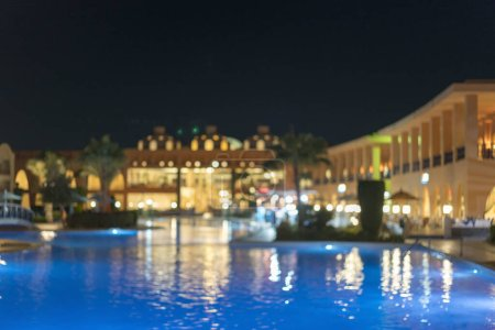 Photo for Huge nightly hotel with pool. Blurry. - Royalty Free Image