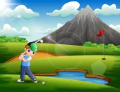 A boy playing golf in the beautiful nature