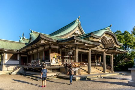 Osaka, Japan - Sep 20th 2018 - Tourist visiting a buddhist temple in Osaka, Japan in a blue sky day