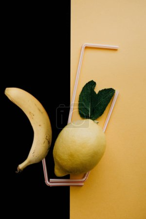Conceptual photography. Lemonade or juice from fresh fruits in a glass of tubes. Mix of lemon and banana