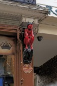 YORK, GREAT BRITAIN - SEPTEMBER 9, 2014: This is a symbolic wooden figurine of a red devil on an old printer house, which, according to legend, is the cause of misprints in the books.