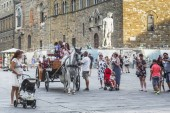 Horse-drawn carriages near the fountain of Neptune, Florence