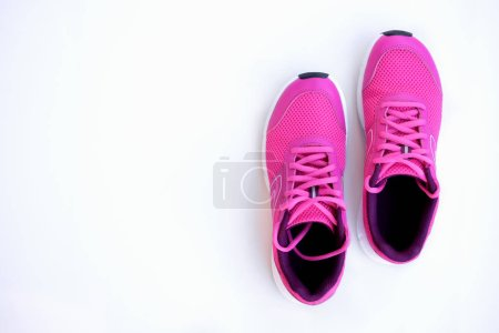 Concept run. Pink running shoes for women on a whi...