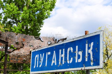 Road sign with the inscription in Ukrainian Lugans...