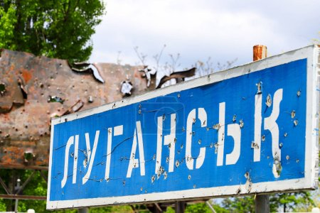 Blue road sign with the inscription in Ukrainian L...