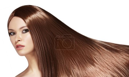 Photo for Beautiful yong Woman with Long Straight Brown Hair. Sexy Fashion Model with Smooth Gloss Hairstyle. Keratine Treatment. Horizontal studio shot - Royalty Free Image