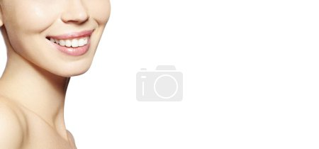 Photo for Beautiful Part of Face Young Woman with White Teeth on White Background. Happy Smile. Wellness and Tooth Care. Copy Space - Royalty Free Image