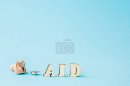 Photo for Hearing aid on blue background. Medical, pharmacy and healthcare concept. Copy space. Empty place for text or logo. - Royalty Free Image