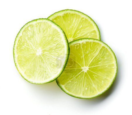 Heap of lime slices isolated on white background, ...