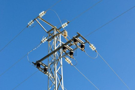 electric grid tower on blue sky