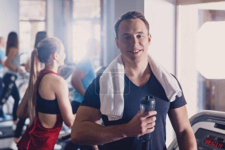 A man rejoices with his result on the treadmill