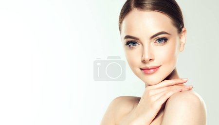 Photo for Beautiful Young Woman with Clean Fresh Skin. Face care . Facial treatment . Cosmetology , beauty and spa . - Royalty Free Image