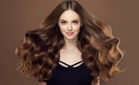 Photo for Beauty girl with long and shiny wavy hair . Beautiful woman model with curly hairstyle - Royalty Free Image
