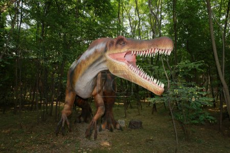 Dinosaur showing teeth in the oral cavity in the amusement park .