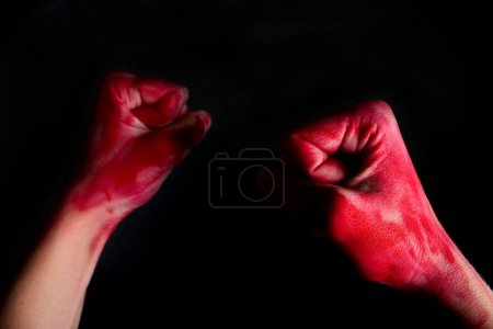 female fists in blood