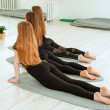 Stretching workout. A group of young girls in blac...
