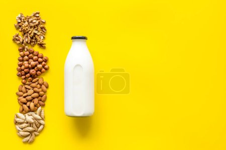Photo for Above view of non-dairy milk alternative - almond hazelnut walnut milk. - Royalty Free Image