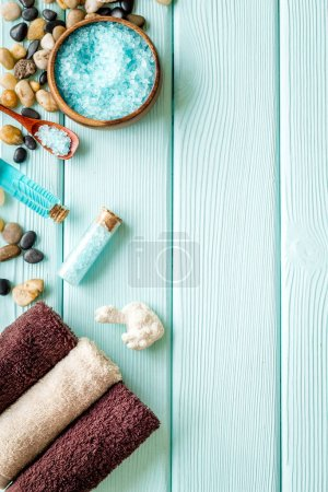 Photo for Spa treatments set with sea cosmetics - salt and aroma oil. Top view. - Royalty Free Image