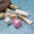 Cosmetic product and woman bag on concert backgrou...