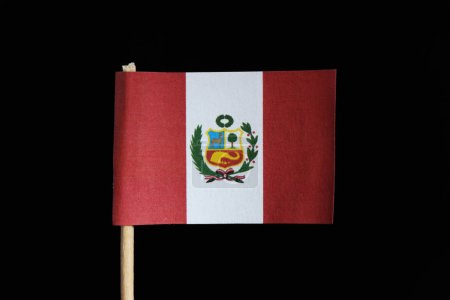 A official and original flag of Peru on toothpick on black background. A vertical triband of red and white with the national coat of arms centered on the white band.