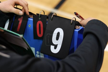 Scorekeeper keep attention during volleyball match...