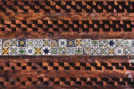 Wall with eastern ornament tile and bricks composition