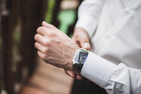 Man in white shirt wearing classic watch, business style concept