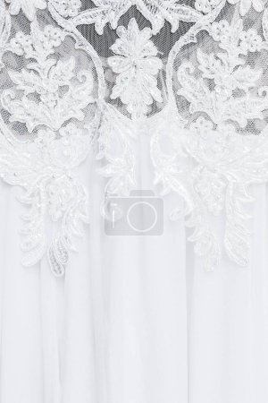 Lace embroidery on wedding dress, close-up