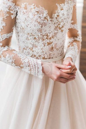 bride in lace white wedding dress, close-up