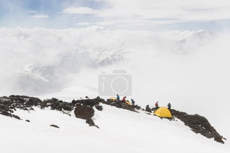 ELBRUS REGION, RUSSIA - JUNE 25, 2017: Group of tourists hiking to top of mount Elbrus