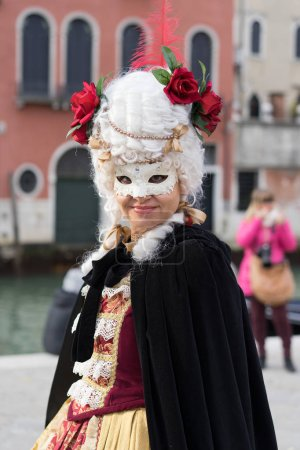 VENICE, ITALY - FEBRUARY 27, 2017: People during the Carnival of Venice. It is an annual festival that starts around two weeks before Ash Wednesday and ends on Shrove Tuesday or Mardi Gras