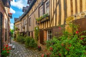 old cozy street with historic half timbered buildings in the the beautiful town of Honfleur, France with nobody