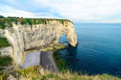 famous coastline with cliffs Aval of Etretat ,Normandy, France, Europe at sunrise