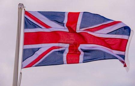 British flag waving in the wind at the Cornish Coast