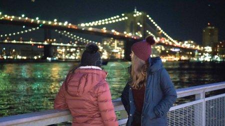 Wonderful place in New York at night the illuminated Brooklyn Bridge