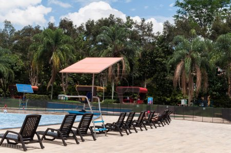 Photo for Medellin, Antioquia/Colombia; mayo 23 de 2019: pool chairs by the pool in the recreational water park. - Royalty Free Image