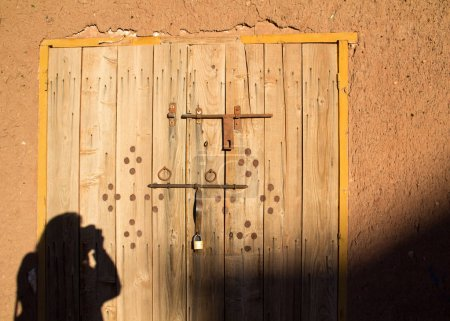 Photo for Africa, North Africa, Morocco, Souss Massa Dra, Ait Benhaddou. Adobe buildings reflect the image of a photographer taking pictures at sunrise. Village listed as World Heritage by UNESCO. - Royalty Free Image