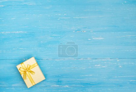 Photo for Gift box with a bow on table. Beautiful New Year and Christmas background. - Royalty Free Image
