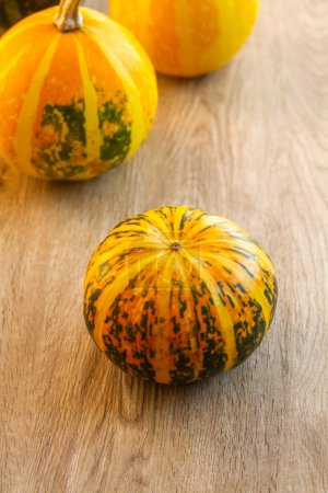 Photo for Decorative pumpkins on a wooden table. - Royalty Free Image