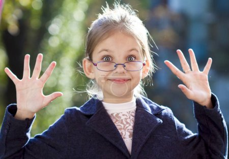 Photo for Portrait of a cute little girl in glasses - Royalty Free Image