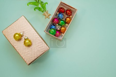Photo for Gift box and christmas balls on the table - Royalty Free Image