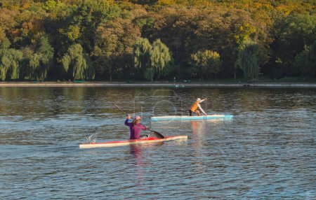 Two rowers on the lake. The concept of a healthy lifestyle.