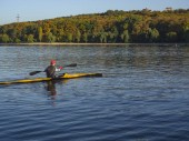 Rower on the lake. The concept of a healthy lifestyle.