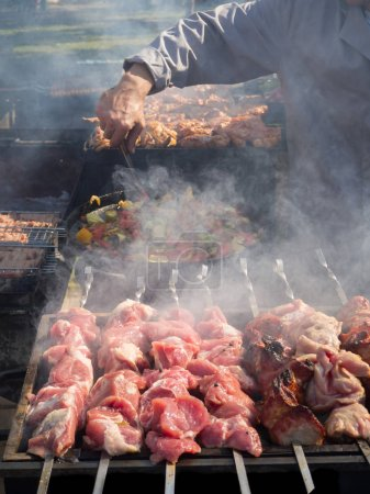 Photo for Barbecue meat preparation. Caucasian barbecue in nature - Royalty Free Image